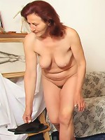 The two hard cocks inside the mature redhead have a good time and get her off