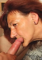 The mature threesome shows the redhead bent over getting dick from both directions
