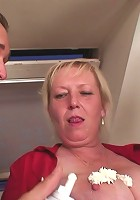 Granny threesome shows her in stockings getting stuffed with two hot cocks at once
