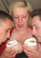 Whipped cream on her tits and two cocks fucking her slutty body makes granny happy