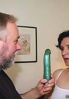 Her desire is to be sexually overwhelmed and the mature hottie has two cocks today