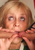 The sexy grandma pays off her debt by enjoying two stiff dicks from the younger men