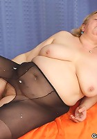 Chubby mature blonde going wild with two guys and their big, rock hard schlongs