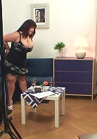 The mature slut is fucked in her pussy and her mouth at the same time during the hot scene