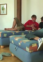The threesome features two young guys and their cleaning lady having hot sex