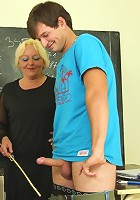 The chubby mature teacher is fucked by two of her naughty students in class