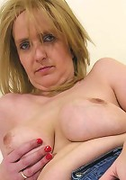 Old and busty mom taking two hard cocks