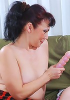 Horny oldie forcing a girl into dildo play