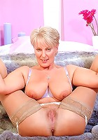 Busty cougar mom fucking a younger guy
