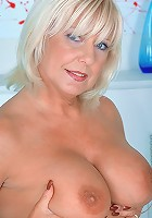 Hot milf bethany masturbates with a red sex toy in the bedroom
