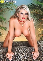Small boobed mature blonde is doing a striptease
