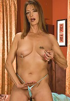 Mature hottie with piercings plays with her clit