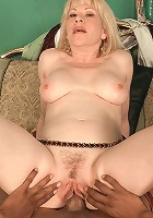 Mature blonde gives young stud a good fuck