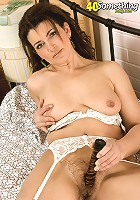 Sexy 40 yr old stuffs with her two holes