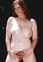 Nude big tit MILF in the backyard