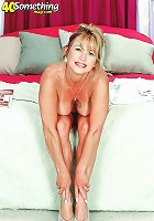 Busty MILF stuffs a huge dildo