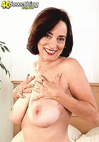 Playful mature lady with big tits