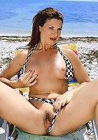 Naughty mom gets kinky at the beach