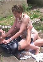 Milf fucks outdoors