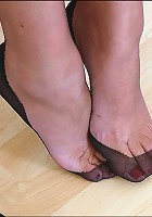 Mature feet in stockings