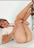 Milf masturbates in hose