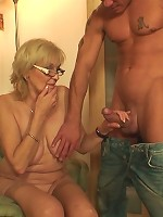 Hot granny has a load of cum on her