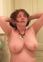 Her big mature tits are seductive